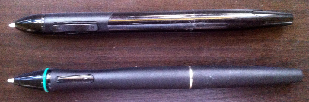 Comparison shot of the original (top) and premium (bottom) styli. The premium shape fits in my hand much better and prevents me from accidentally pressing the rocker button.